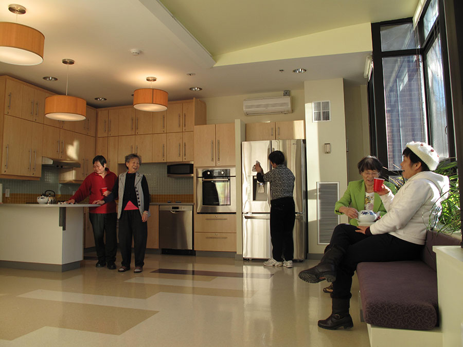 Seniors having a good time in their new kitchen.