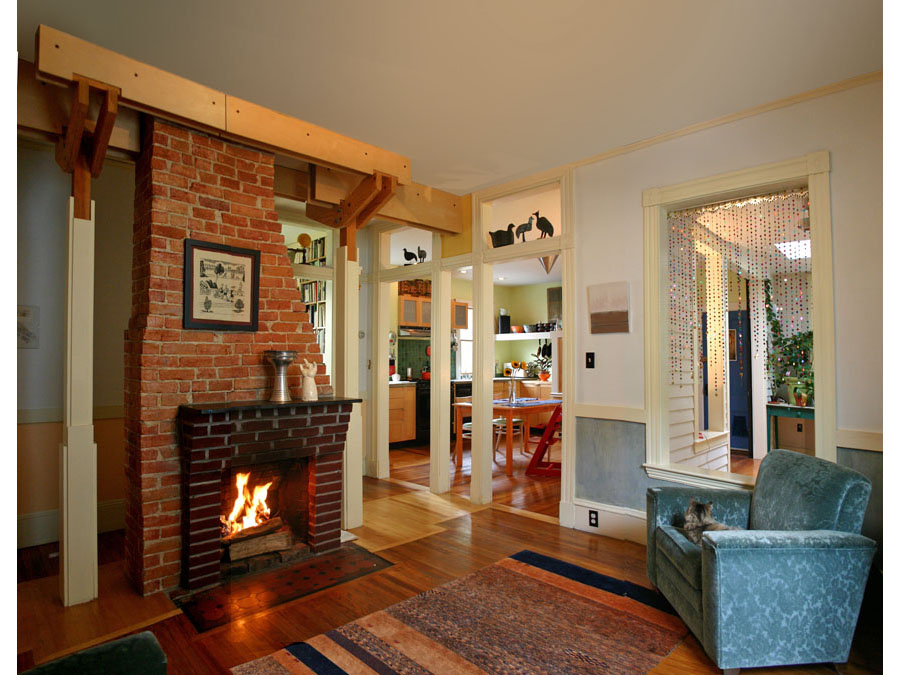 Home design creates this spectacular fireplace centerpiece in the living room of the Cambridgeport house.