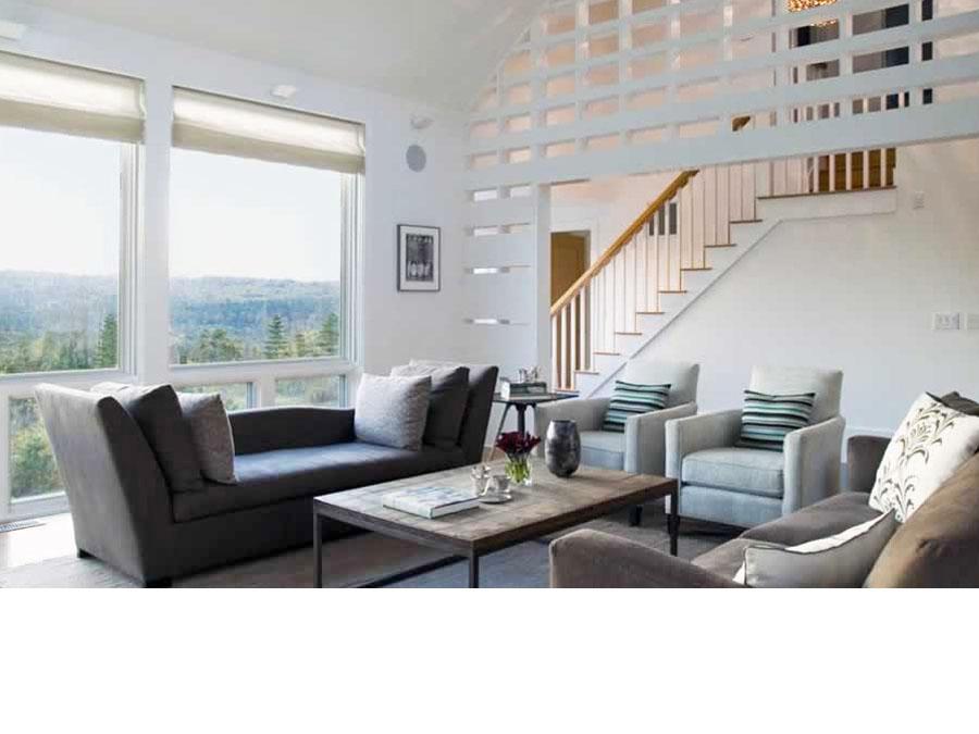 Home design creates a natural light filled living room.