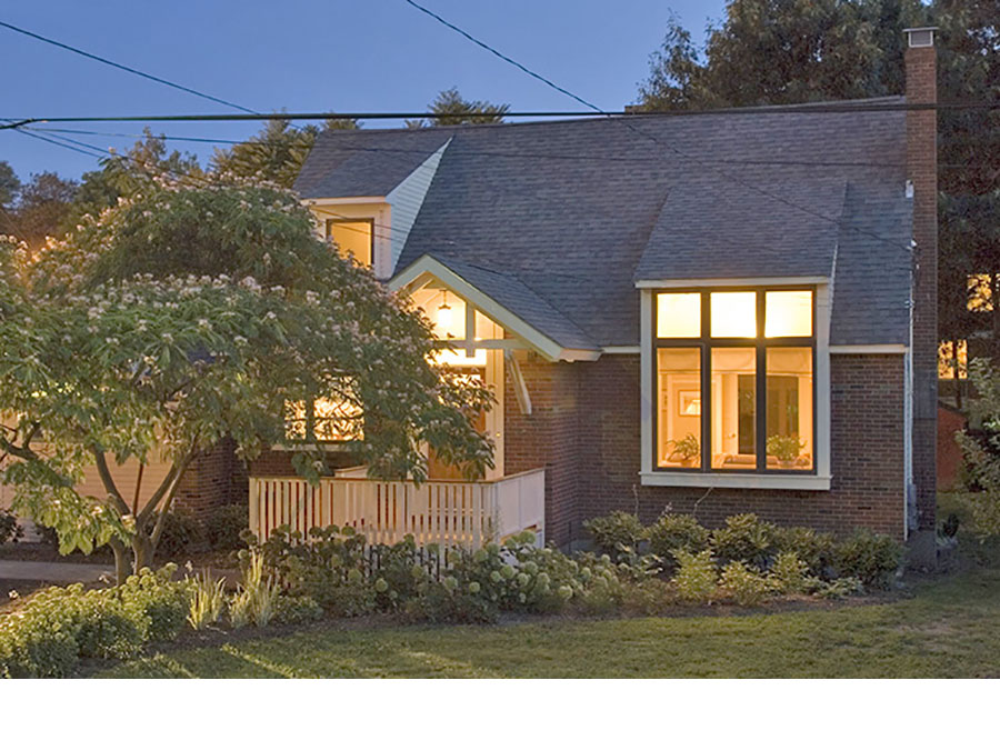 Green home design creates evening beauty at the Jamaica Plain house.