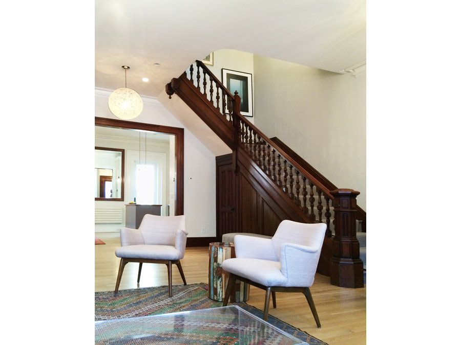 Living room decorated with stylish furniture in the South End rowhouse.