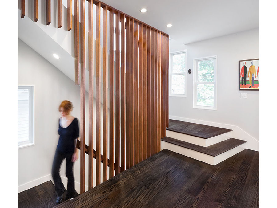 Screened stairs and dark floors in this home renovation.
